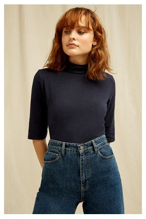 Cecily Turtleneck Top In Navy